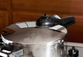 Pressure being released from cooker on hob — Stock Photo