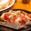 Royalty-Free Stock Photo: Deep dish pizza in metal serving dish
