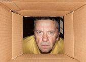 Senior man staring into cardboard box — Stock Photo