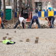 Stock Photo: Workmen rebuild cobbled street in Brussels
