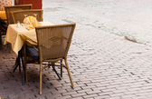 Empty cafe tables in Brussels cobbled square — Stock Photo