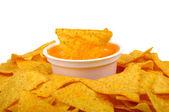 Nachos and cheese sauce — Stock Photo