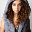 Sexy woman with perfect body in the fur coat. — Stock Photo