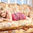 The pretty woman has relaxed on a sofa. — Stockfoto