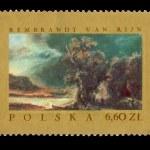 un sello impreso en Polonia muestra pintura de rembrandt van rijin - paisaje con el parecido del samaritano misericordioso — Foto de Stock