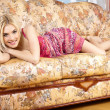 The pretty woman has relaxed on a sofa. — Stock Photo