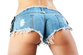 Sexy woman body in jean shorts. — Stock Photo