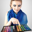 Stock Photo: Portrait of beautiful woman with makeup palette. — Foto de Stock