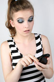 Portrait of woman with black phone. — Stock Photo