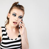 Closeup portrait of a cute young girl talking on mobile phone. — Стоковое фото