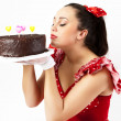 A young woman with chokolate cake. - Stock Photo