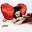 Girl shoots a pistol at Valentine's Day. — Stock Photo #8914949