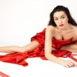 Beautiful young woman is covered with red cloth. — Stock Photo #9020664