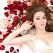 Portrait beautiful young woman with roses petals. — Stock Photo #9124340