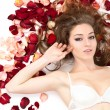 Portrait beautiful young woman with roses petals. — Stock Photo