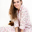 Picture of a morning sweet young girl in pink pajamas. — Stockfoto #9124425