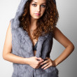 Beautiful young woman in a fur coat. — Stock Photo