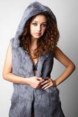 Beautiful young woman in a fur coat. — Stockfoto