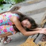 Young beautiful women with long hair near river. — Stock Photo