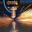 Foto Stock: Laser cutting of metal sheet with sparks