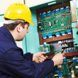 Electrician checking current at power line box — Stock Photo #10094590