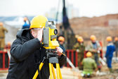 Surveyor works with theodolite — Stockfoto