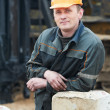 Stock Photo: Builder in dirty workwear at construction site