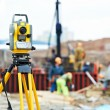 Surveyor equipment theodolite at construction site - Stock Photo