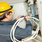 Electrician installing energy saving meter — Stock Photo