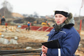 Builder resident engineer at construction site — Stock Photo