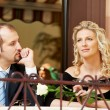 Man and girl with wine at cafe on a date — Stock Photo #10145041