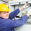 Electrician measure voltage with multimeter — Stock Photo
