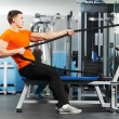 Bodybuilder man doing exercises in fitness club — Stock Photo