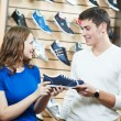 Man and assistant at shoe shopping — Stock Photo #10352572