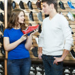 Man and assistant at shoe shopping — Stock Photo #10352596