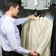 Royalty-Free Stock Photo: Young man choosing suit in clothes store