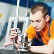 Worker measuring cutting tool - Stock Photo