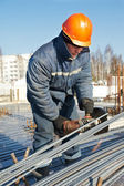 Builder works with concrete reinforcement — Stock Photo