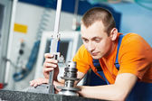 Worker measuring cutting tool — Stock Photo