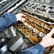 Machanic repairman at automobile car engine repair — Stock Photo #10390594