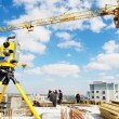 Surveyor equipment theodolite at construction site — Stock Photo