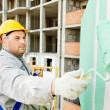 Stock Photo: Builder facade painter at work