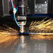 Laser cutting of metal sheet with sparks — Stok fotoğraf #10394462