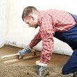 Plasterer concrete worker at floor work — Stock Photo #10394846