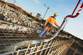 Builder worker at concrete pouring work — Stock Photo