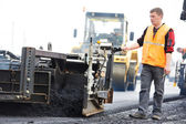 Worker at asphalting works — Stock Photo