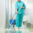 Stock Photo: Womcleaning hospital hall