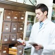 Pharmacy chemist man in drugstore — 图库照片