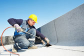 Flat roof covering works with roofing felt — Foto Stock