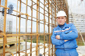 Foreman at construction site with working drawings — Stock Photo